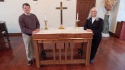 Craftsman and artist, Ed Berkley, and chaplain Kathy Redig with the new altar to be dedicated at Watkins Great Hall.
