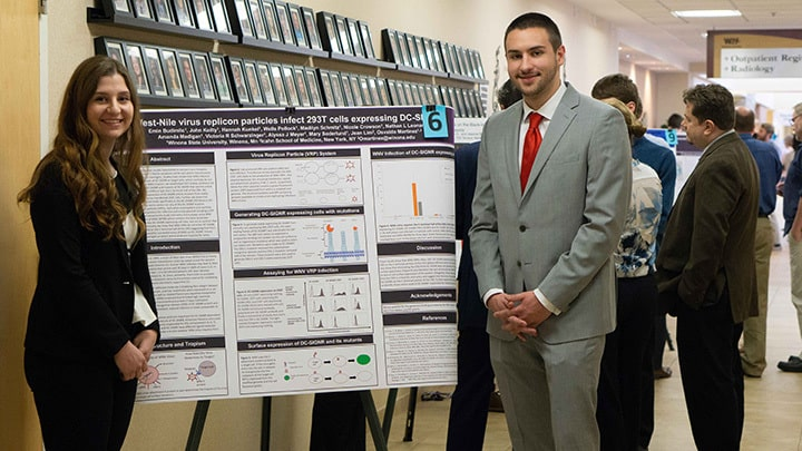 WSU students post with their project at Winona Health's 2018 Student Research Fair.