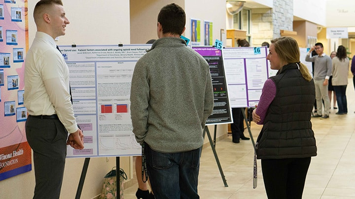 WSU student discusses his project at Winona Health's 2018 Student Research Fair.