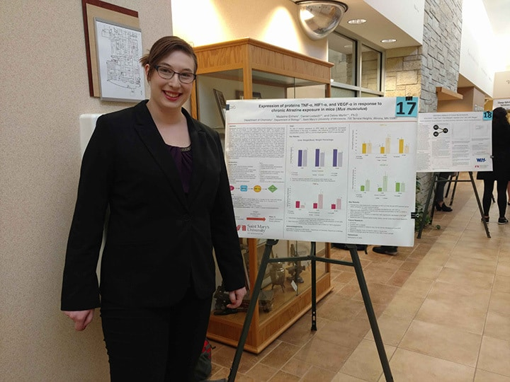 WSU student displays her project at Winona Health's 2018 Student Research Fair.