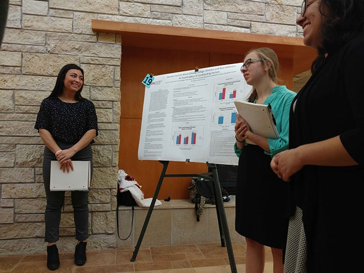 WSU students discuss their project at Winona Health's 2018 Student Research Fair.