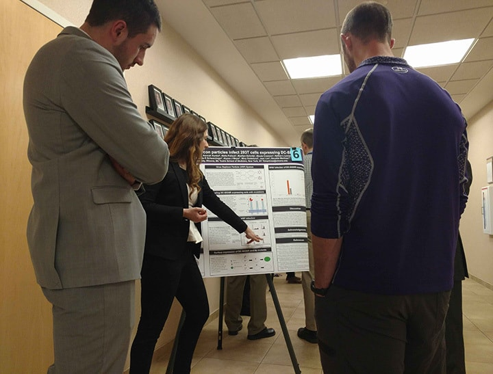 WSU student discusses her project at Winona Health's 2018 Student Research Fair.