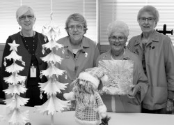 Holiday Happiness co-chairs, Mary Breza, Carole Matejka, Diane Barge and Mary Brenno, with a few items available during the event.