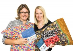 Sara Gabrick and Robin Trombetta with a sample of their pillowcases for surgery patients.