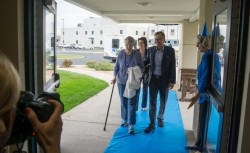 Lake Winona Manor residents and staff rolled out the blue carpet to welcome Steve Blue and his mom, Helen, to Steve Blue Day. Residents were celebrating Blue to thank him for raising money to purchase the new bus, which will take them on many adventures.