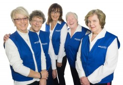 Winona Health Volunteer officers in their new uniforms with their new retired pink smock are (l-r): Sue Anderson, secretary; Irene Mulyck, treasurer; Bernadette Thicke, vice president; Barb Pozanc, assistant treasurer; and Kim Schwab, president.