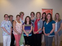 Winona Health Auxiliary Carol Hill Scholarship recipients are pictured with scholarship committee members (l to r): Angie Duell, Nancy Enochs, Sheryl Miller, Cheryl Nash, Rachel Schmidt, Rebecca Lamberty, Kris Cichon, Emily Etlicher, Erin Hanson and Michelle Sass